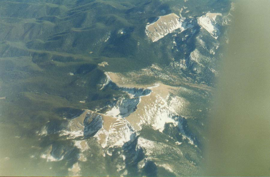 views of deserts and Rocky Mountains from a plane