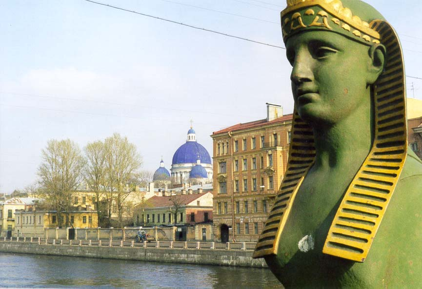 A sphinx (facing north) on Egypt Bridge across...at background. St.Petersburg, Russia