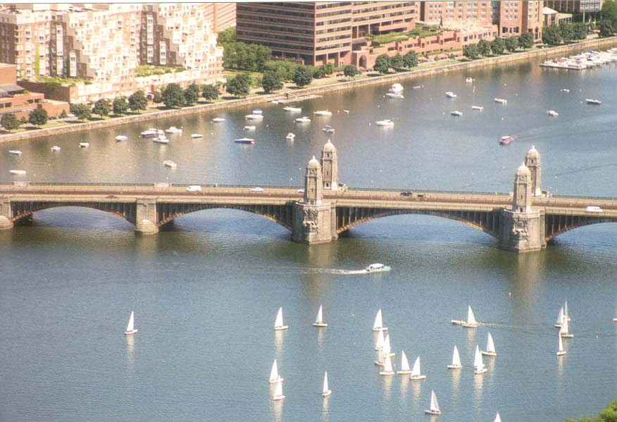 View of Longfellow Bridge across Charles River...Hancock Tower in Boston. Massachusetts