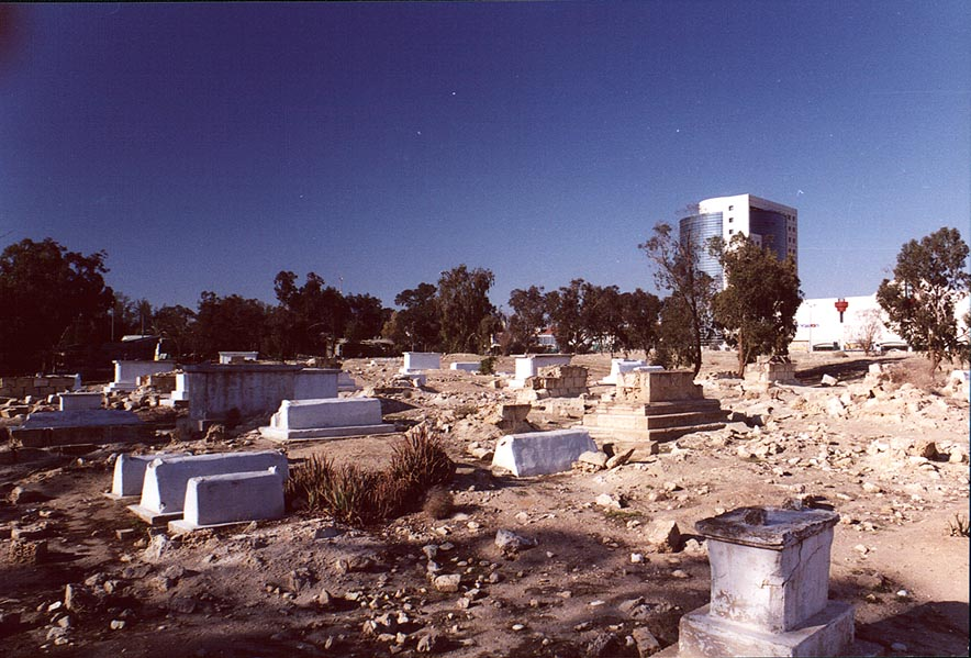 Destroyed and abandoned Muslim Cemetery in...is on the background. The Middle East