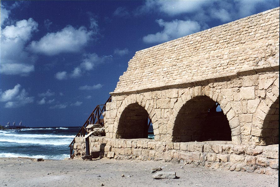 Roman aqueduct in Caesarea on the beach of Mediterranean Sea. The Middle East