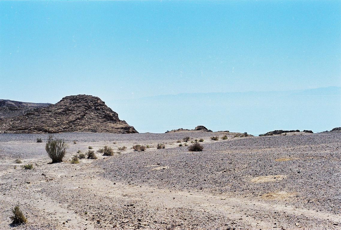 Rim of the plateau, with misty Jordan mountains, near Ein Bokek. The Middle East