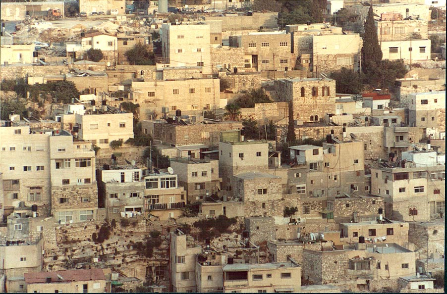 View of Silwan village from a wall of Old City of Jerusalem at evening. The Middle East