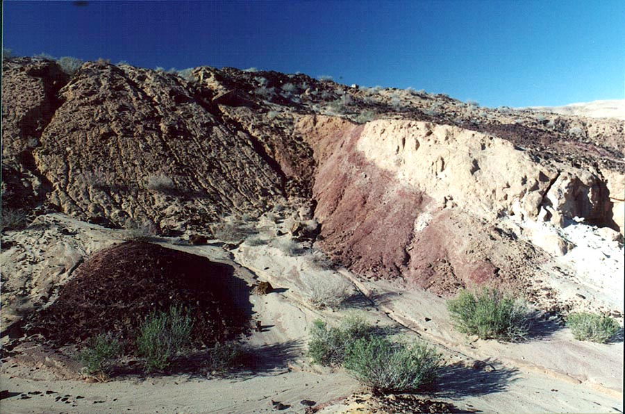 Big Crater (Makhtesh Gadol), multicolored sands behind picnic tables. The Middle East