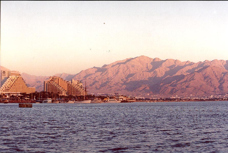 Eilat hotels and Edom mountains in Jordan during sunset. The Middle East