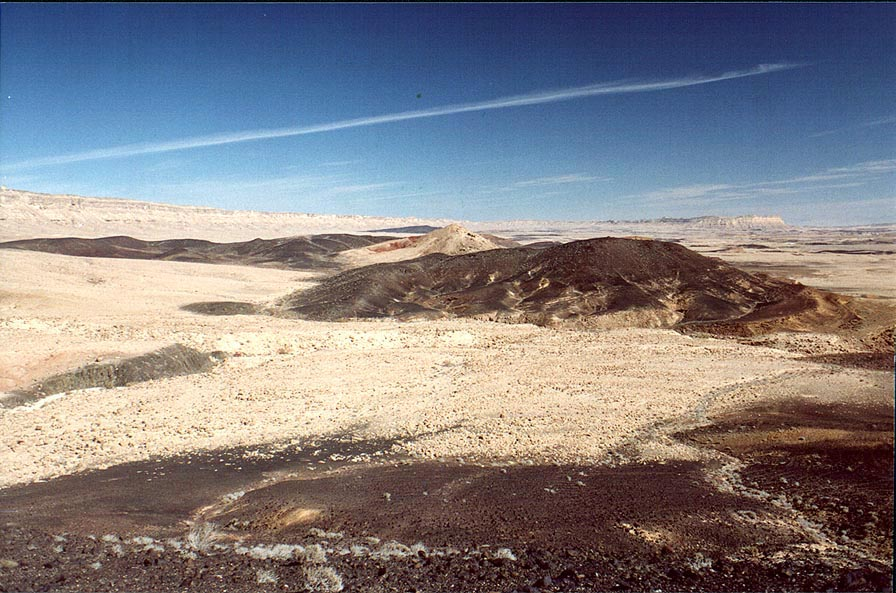 A bottom of Ramon Crater, with hills covered by...a bank of a dry river. The Middle East