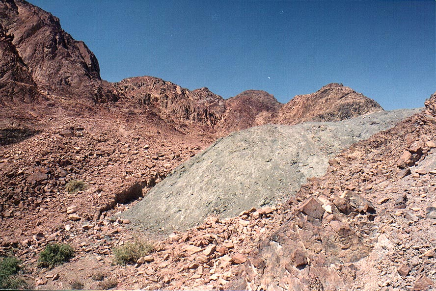 Lawn rocks of olivine on Geological Trail through Timna Mountains. The Middle East