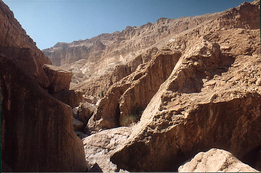 A trail between rocks behind En Namer spring in...west from Masada. The Middle East