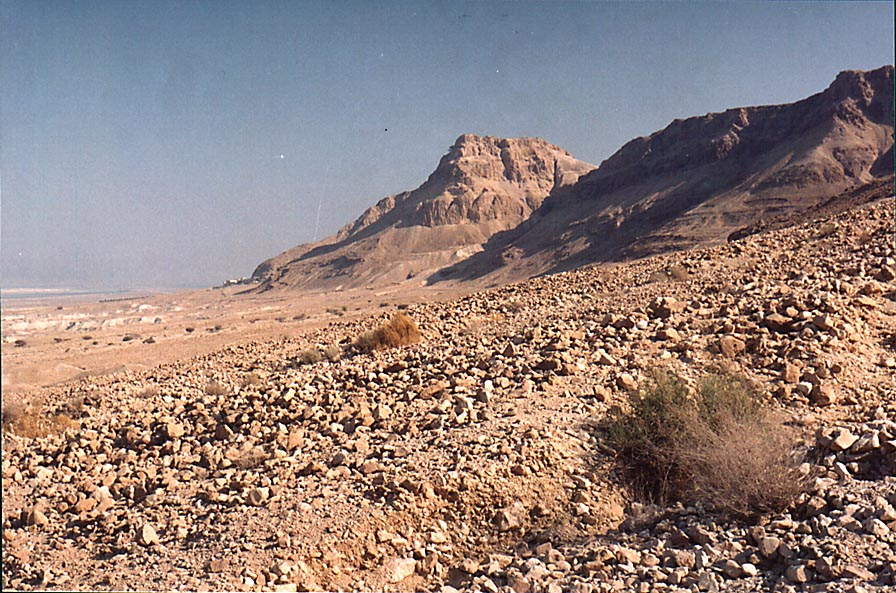 View of a hill with Masada fortress on the top...Masada at evening. The Middle East