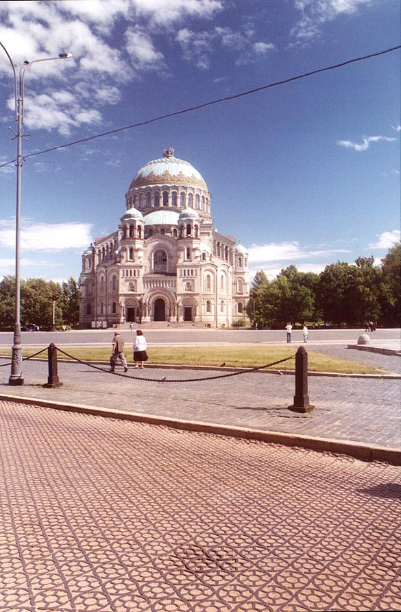 A steel paved road and the maritime cathedral. Kronstadt, Russia