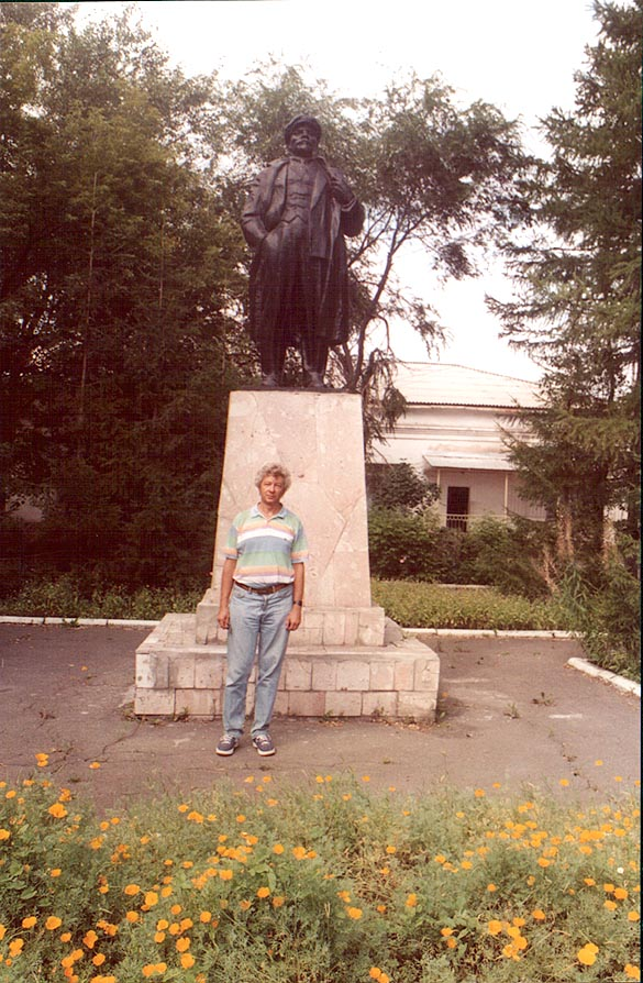 A.S. in front of a monument of V. I. Lenin in a...near Cheliabinsk, south Ural. Russia