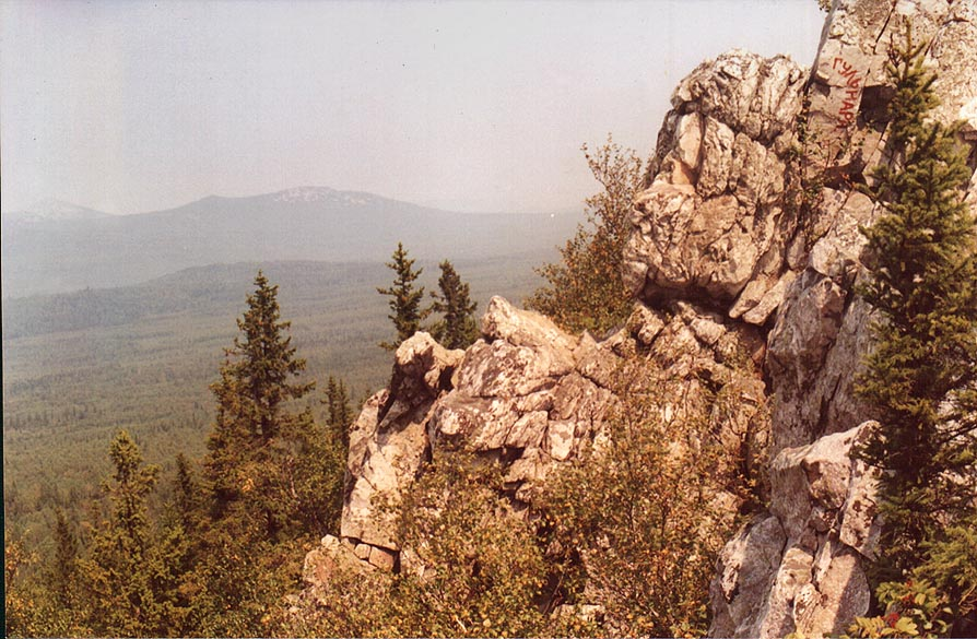 Rocks and forest of Aleksandrovskaya Sopka hill near Zlatoust, Southern Ural. Russia