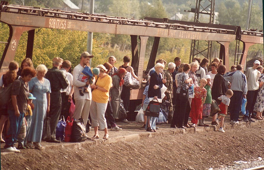 Passengers waiting a local train at a railroad...west from Cheliabinsk. Russia