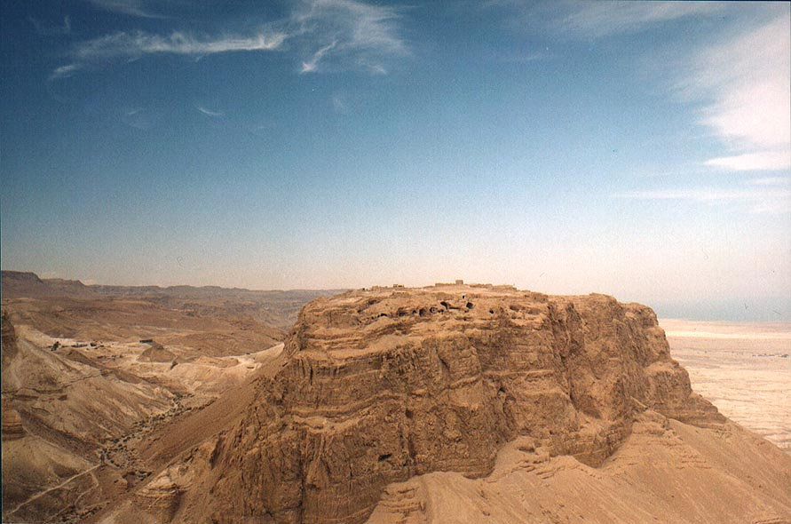 View of Masada hill north from Mount Eliazar...Sea (sun in clouds). The Middle East