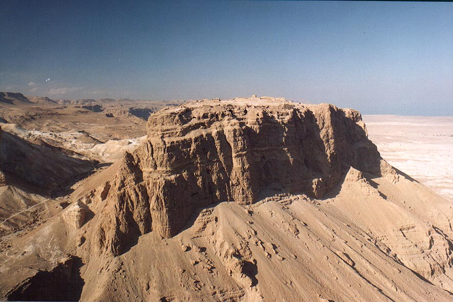 View of Masada hill north from Mount Eliazar...Dead Sea (bright sun). The Middle East