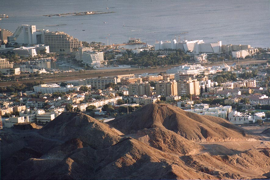 Eilat hotels at Red Sea behind volcanic mountains...Shahmon at evening. The Middle East