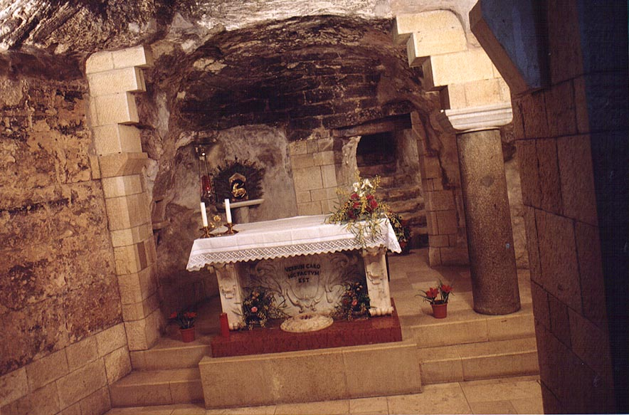 A cave behind a fence in the Church of...Grotto of the Virgin). The Middle East
