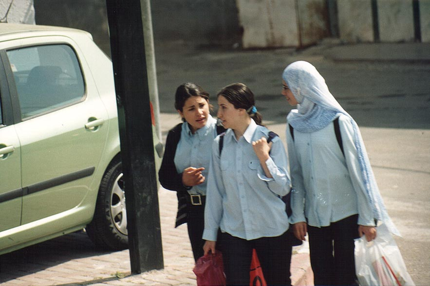 View of schoolchildren from a bus during traffic jam. Nazareth, the Middle East