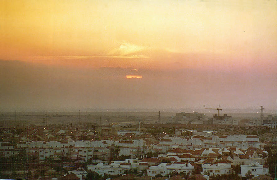 Sunset over Ramot from a hill with Palmach memorial. Beer-Sheva, the Middle East