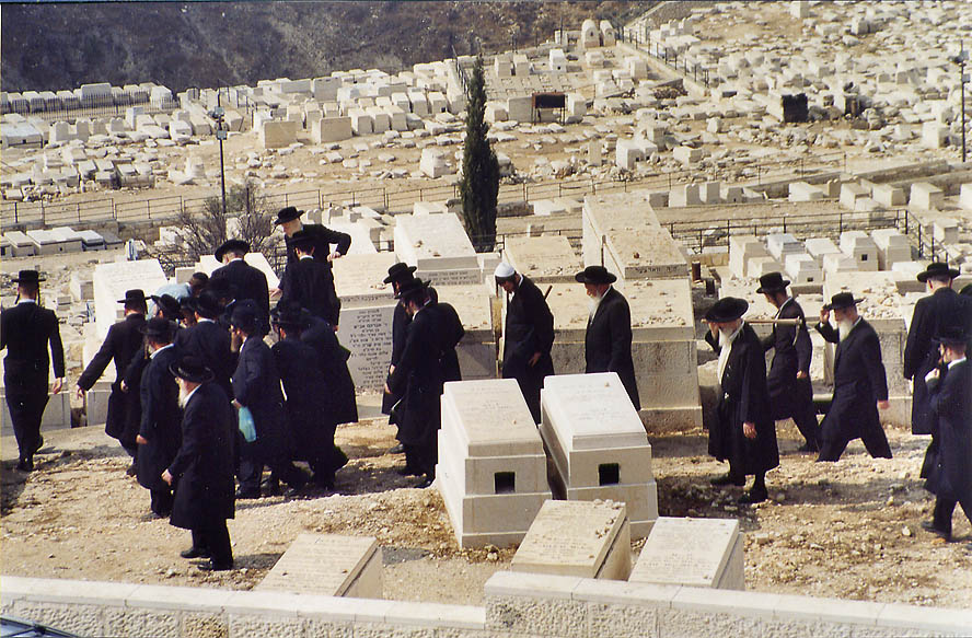 Burial ceremony in Jewish cemetery on the slope...of Olives. Jerusalem, the Middle East