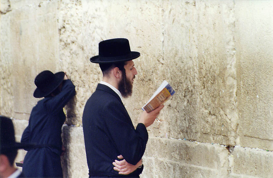 Praying in front of the Western Wall. Jerusalem, the Middle East
