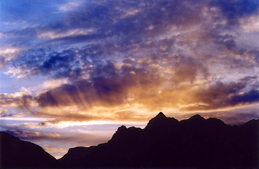 Sunset over volcanic rocks of Timna Massif, view...north from Eilat. The Middle East