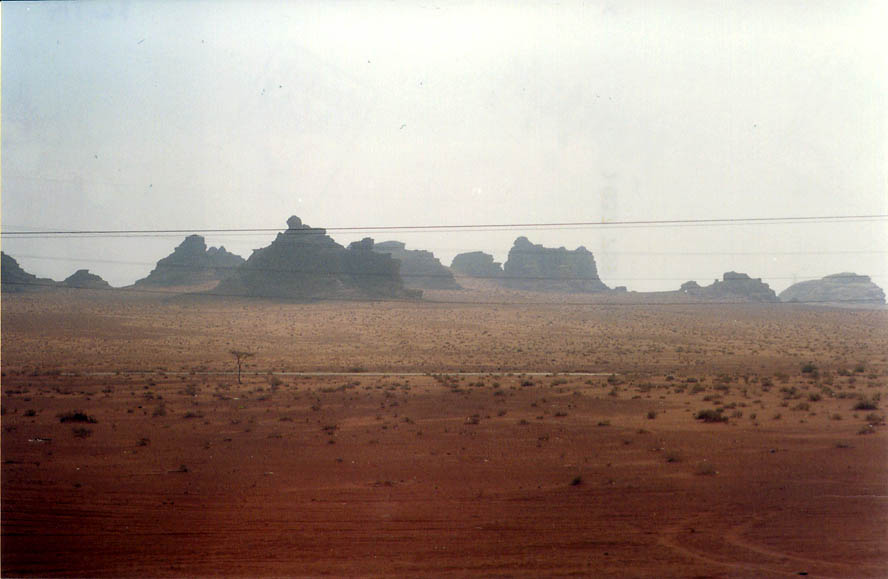 Wadi Rum desert along a road north from Akaba, view from a bus. Jordan