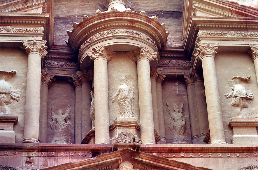 Statue of Isis and Hellenistic columns of the...Nabataean tomb) in Petra. Jordan