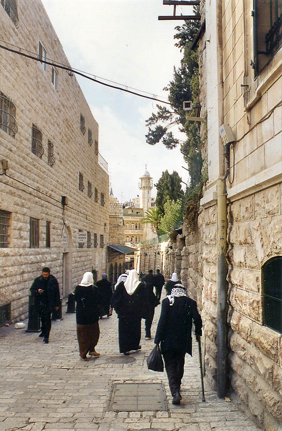 Moslems returning after a Friday worship on Via...Old City of Jerusalem. The Middle East