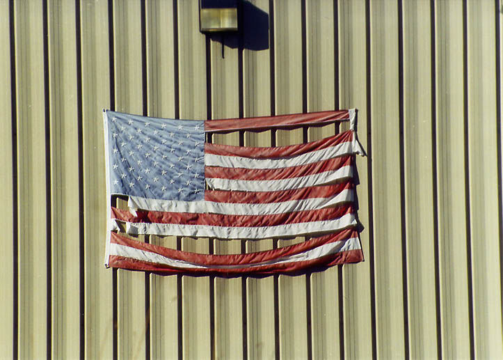 A worn flag on People, Inc. garage in Riggenback Rd. in northern Fall River. Massachusetts