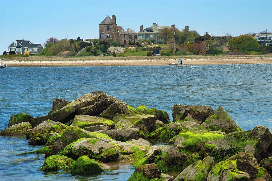 A rocky reef at low tide, Westport River and the...from Horseneck Point. Massachusetts