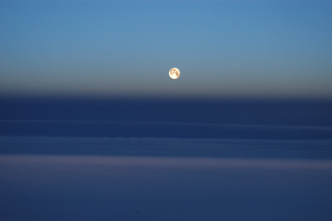 Moonset over Atlantic, around 100 miles north...of a plane Boston-Paris. 6:59 GMT