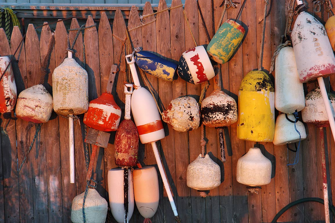 Floats on a fence of a house on Little Beach near Allen's Pond. Dartmouth, Massachusetts