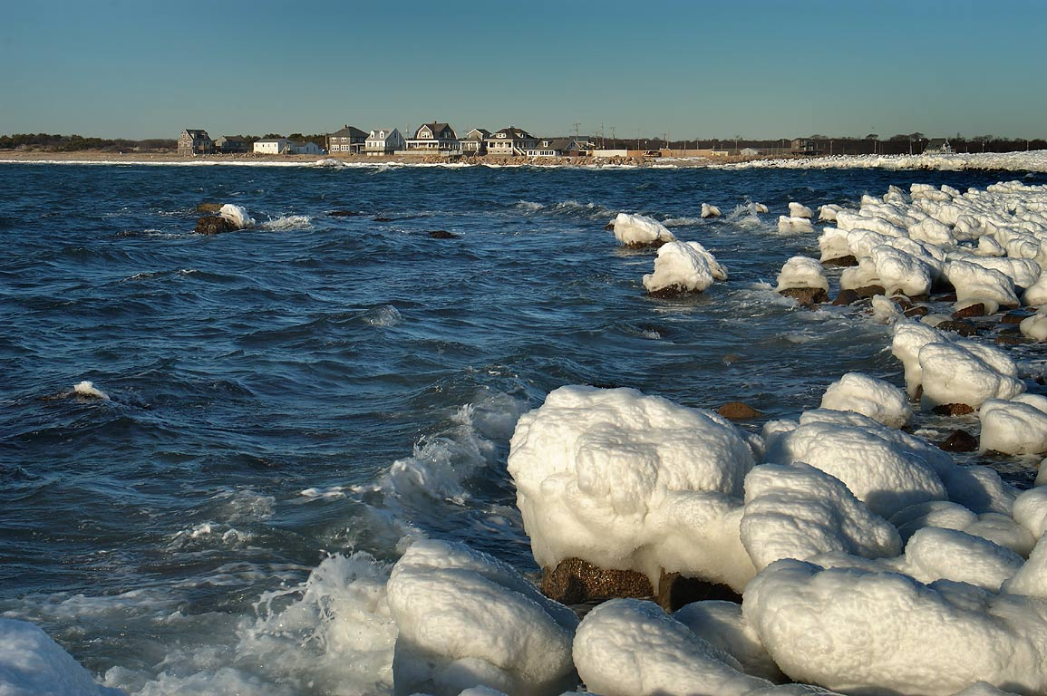 Icy stones and Horseneck Beach from Gooseberry Point. Westport, Massachusetts