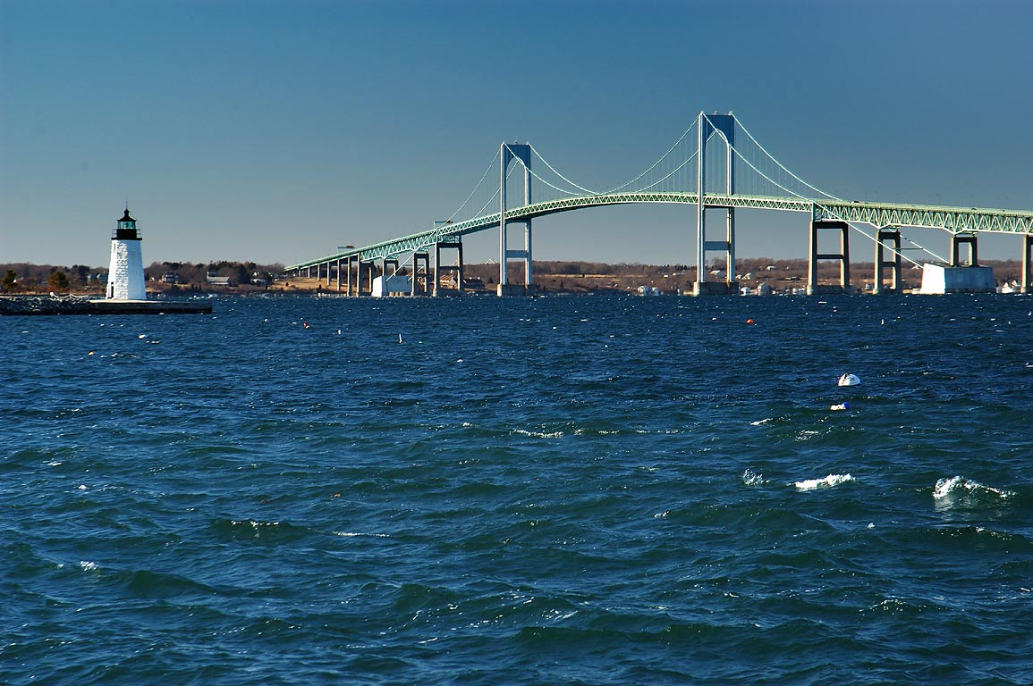 Narragansett Bay, Goat Island Lighthouse and...Island causeway. Newport, Rhode Island