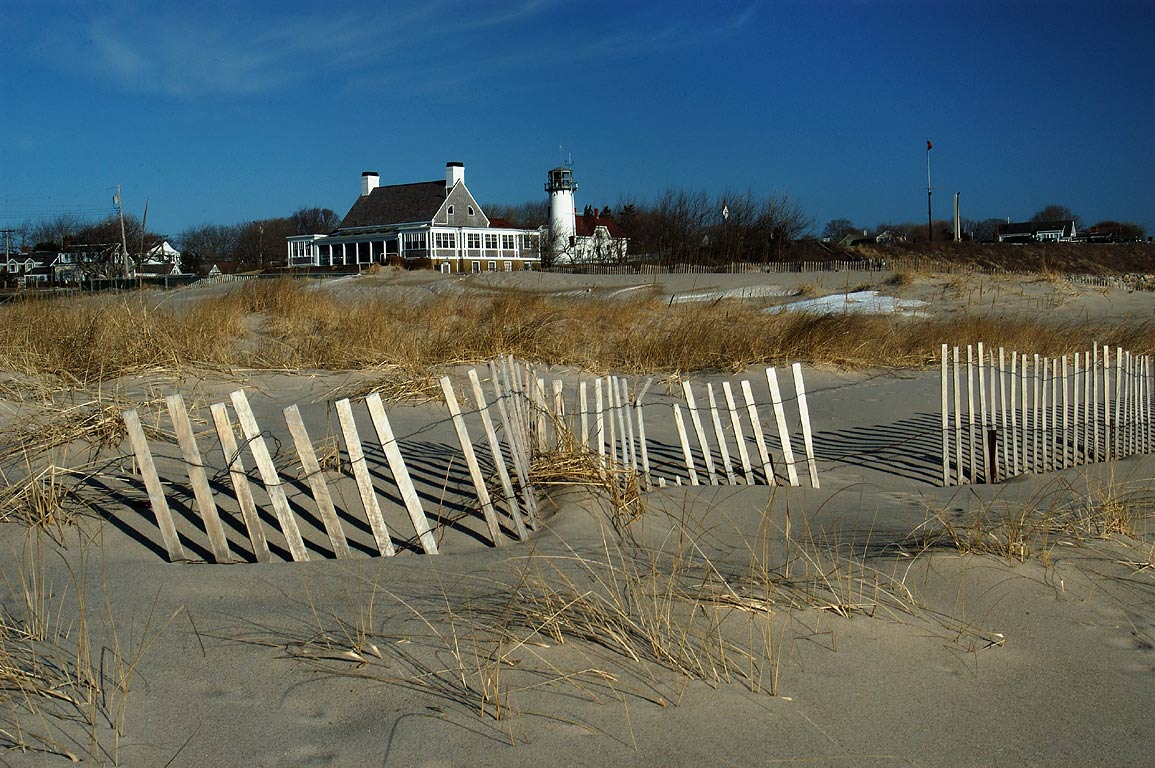 Beach fences and Chatham Lighthouse. Cape Cod, Massachusetts