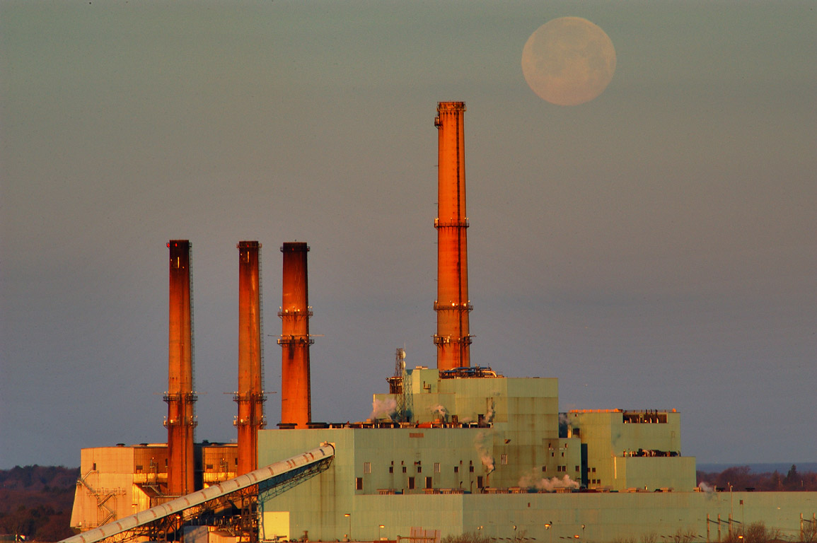 Moonset over Brayton Point Power Plant in...across Mount Hope Bay. Massachusetts