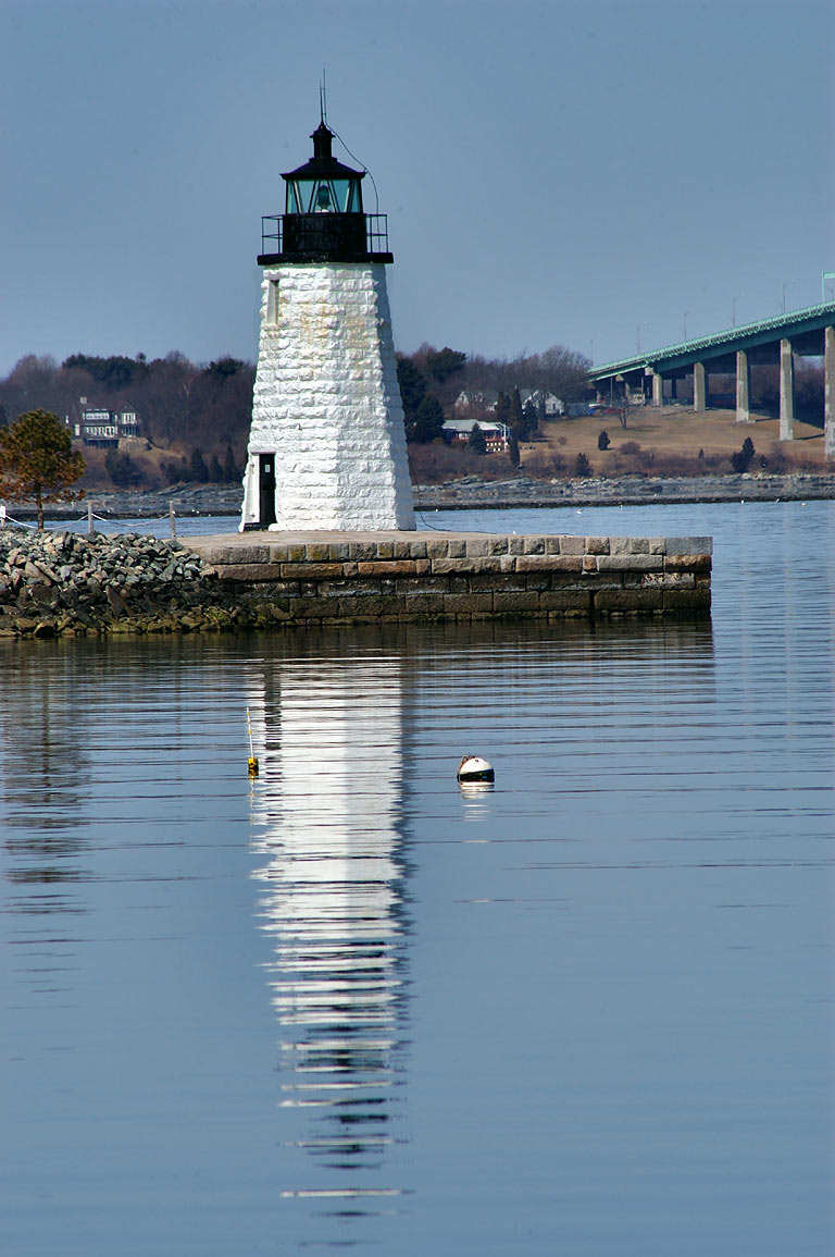 Goat Island Lighthouse and Newport Bridge from Goat Island causeway. Newport, Rhode Island