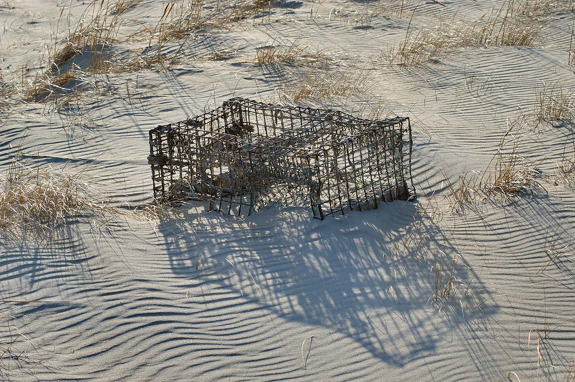 A lobster pot in sands of Horseneck Beach. Westport, Massachusetts