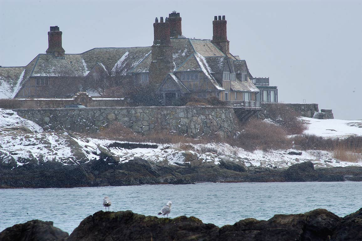 Spouting Rock and the Waves Mansion from Bailey Beach in Newport. Rhode Island