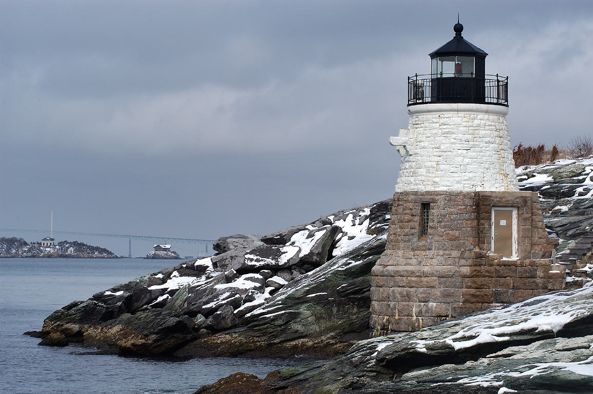 Castle Hill Lighthouse after snowfall. Rose...in background. Newport, Rhode Island
