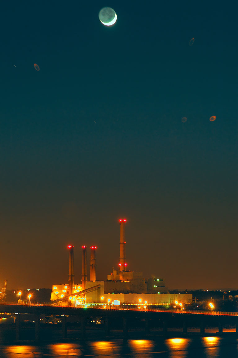 Crescent moon over Brayton Point Power Plant and...District of Fall River. Massachusetts