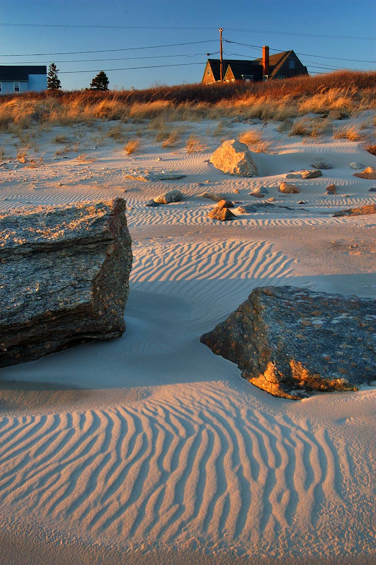 A rocky beach and dry sand ripples at the end of...in Acoaxet. Westport, Massachusetts
