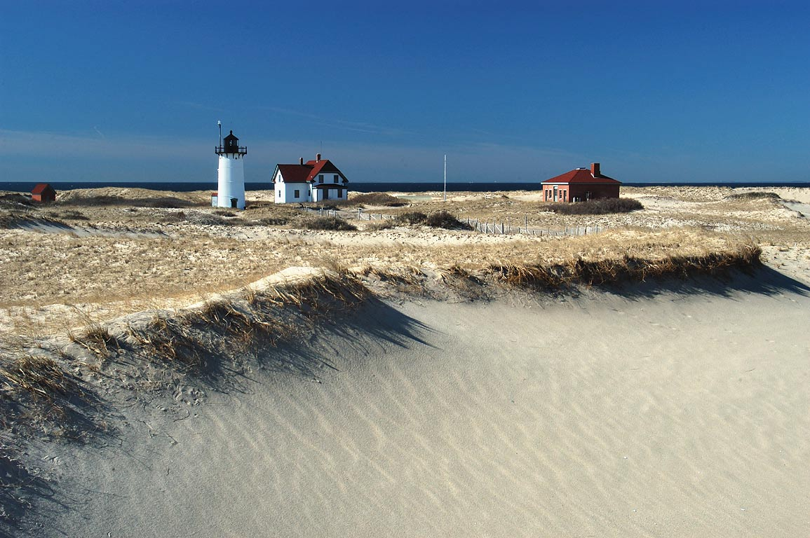 Race Point Light in dunes of Cape Cod. Provincetown, Massachusetts