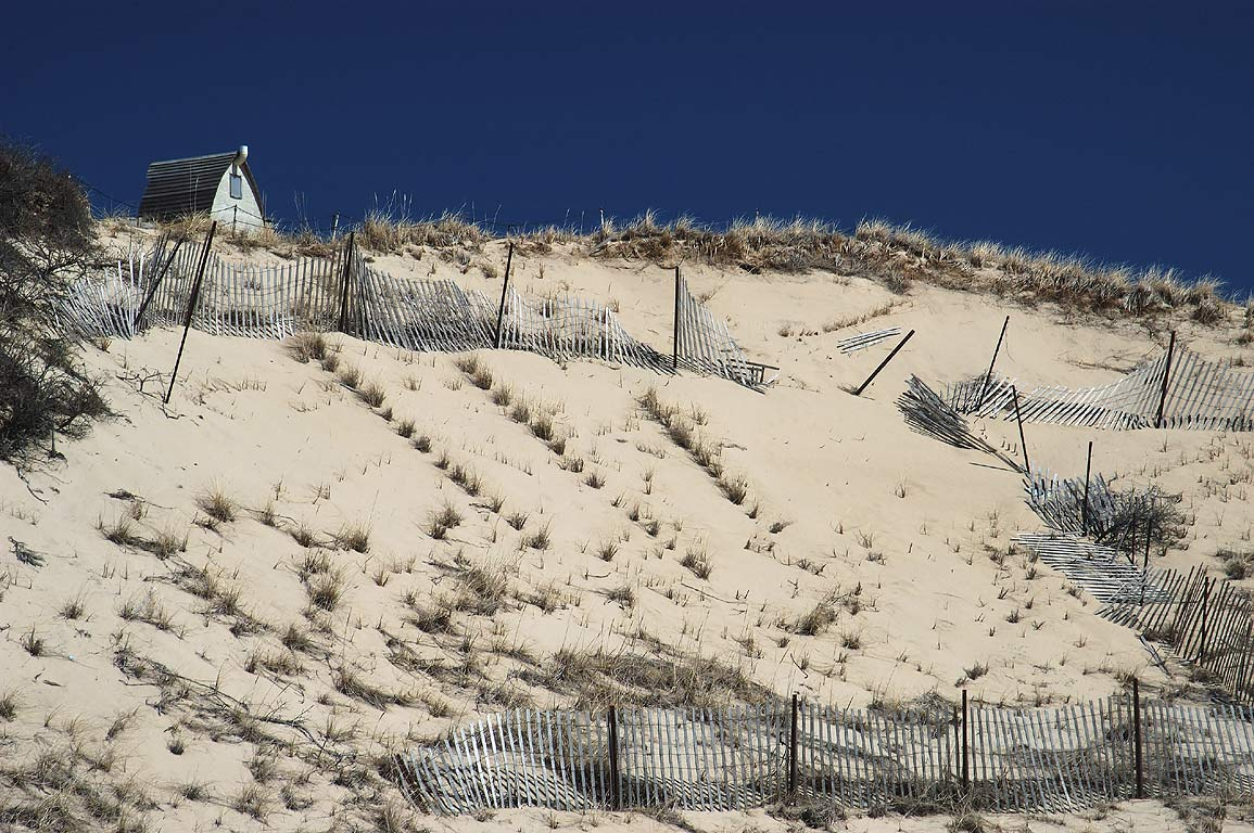 Provincetown dune shacks near a beach, view from Snail Trail in Cape Cod. Massachusetts