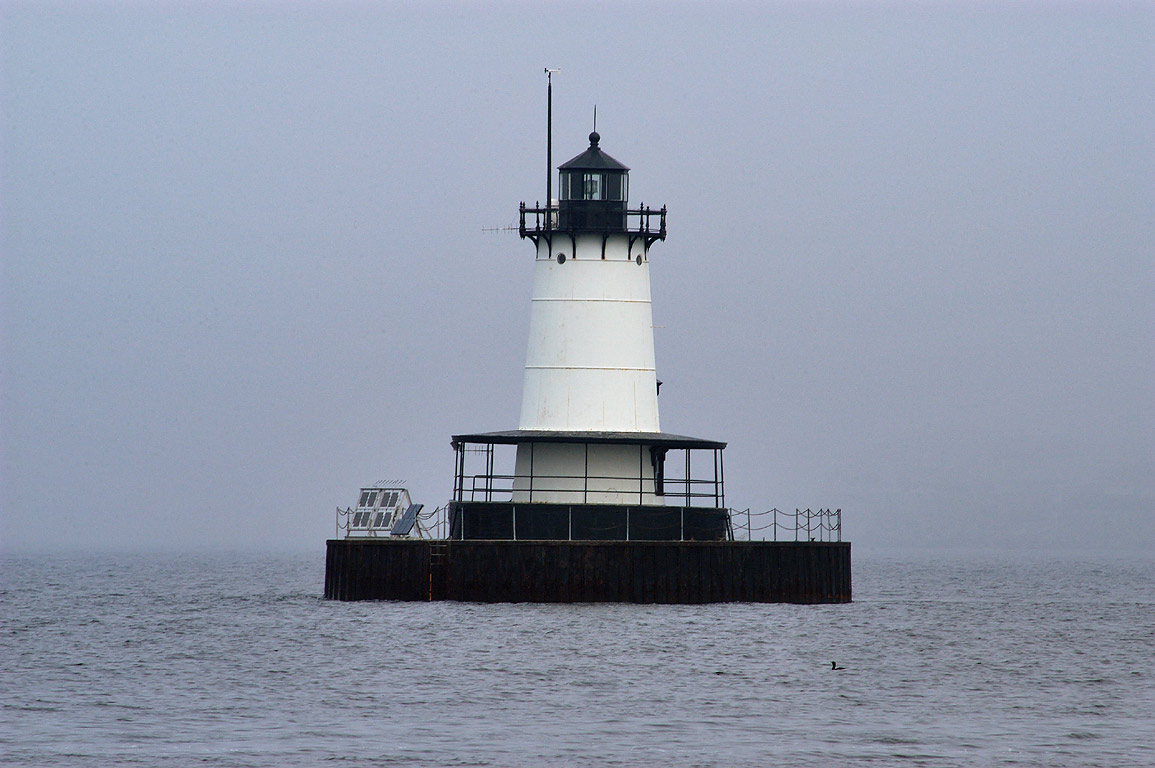 Borden Flats Lighthouse in Mount Hope Bay, in fog...the marina. Fall River, Massachusetts