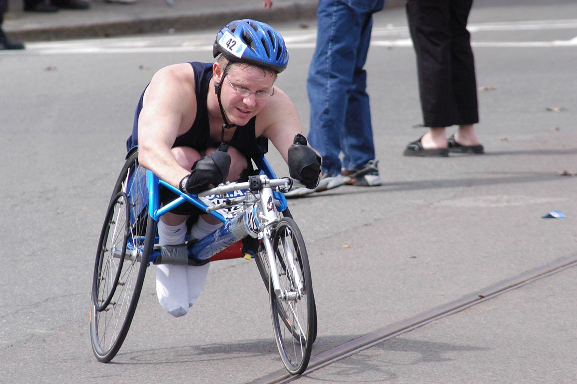 David Ford (USA) on a wheelchair in Boston Marathon, at Cleveland Circle. Massachusetts