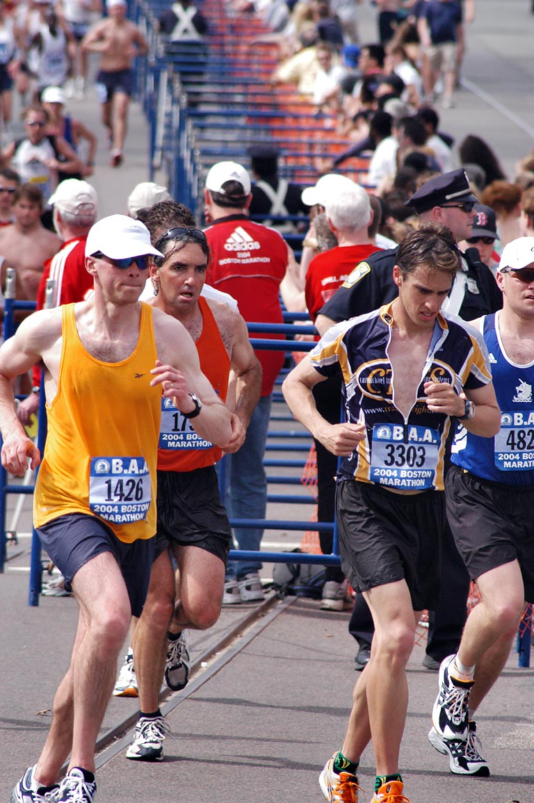 Mass of rank and file runners in Boston Marathon...Circle, in warm day. Massachusetts