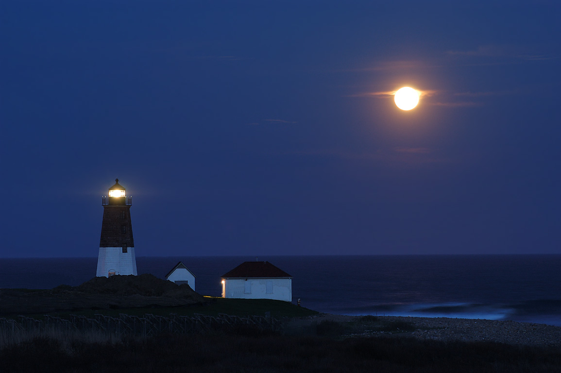 Moonrise with Point Judith Light in Narragansett, view from a WWII bunker. Rhode Island