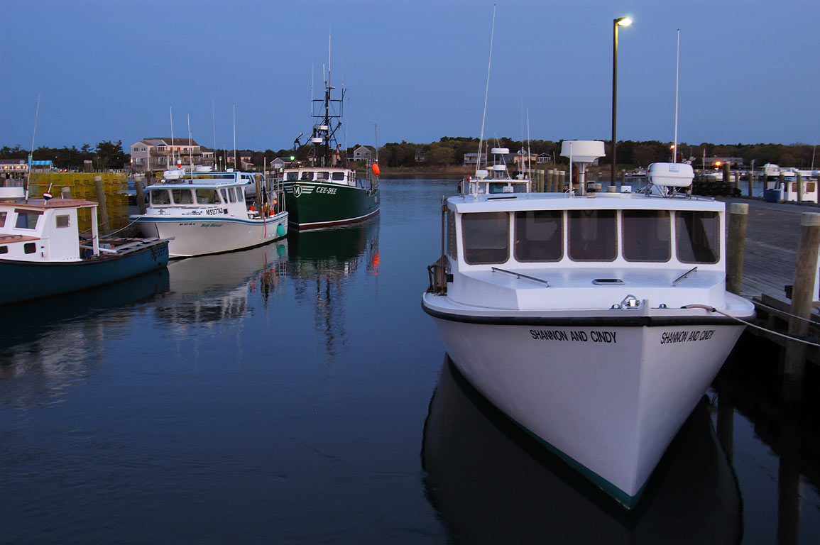 Fishing boats in Lees Wharf at Westport Point at evening. Massachusetts